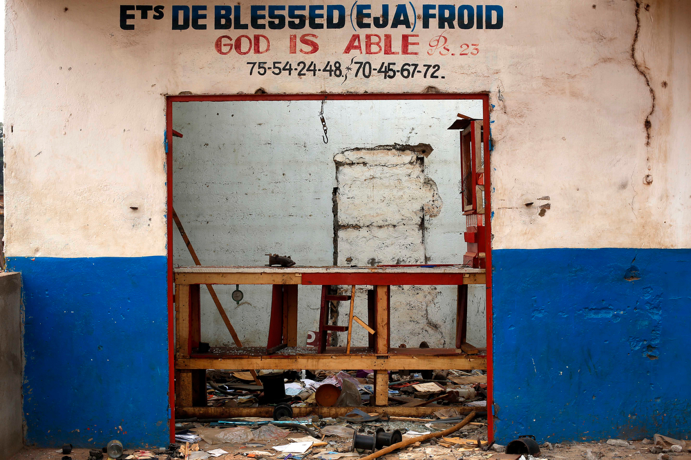 . A Muslim shop stands looted in the Miskin district of Bangui, Central African Republic, Tuesday Feb. 4, 2014. (AP Photo/Jerome Delay)