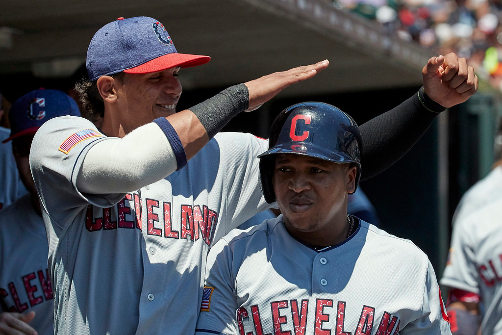 . Cleveland Indians\' Jose Ramirez, right, is congratulated by Erik Gonzalez, left, after hitting a home run against the Detroit Tigers during the third inning of a baseball game in Detroit, Sunday, July 2, 2017. (AP Photo/Rick Osentoski)