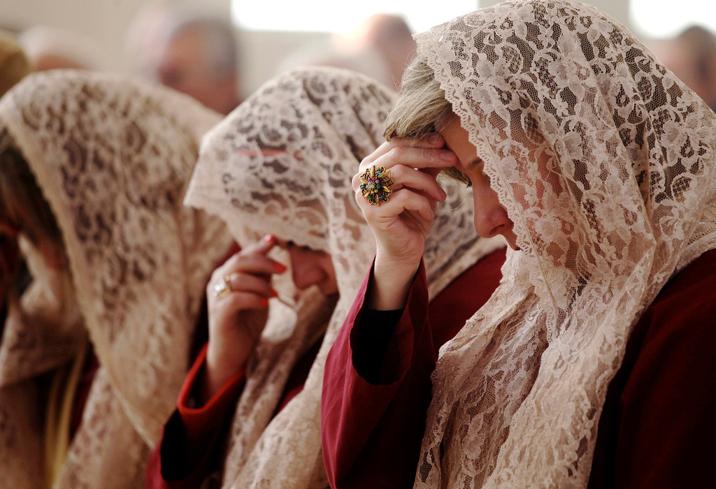 . The women of Saint Afram Syrian Orthodox church\'s choir pray during morning Christmas mass in Amman, Jordan, Wednesday, Dec. 25, 2013. Syrian and Iraqi Orthodox Christian families prayed for peace in their countries. (AP Photo/Mohammad Hannon)