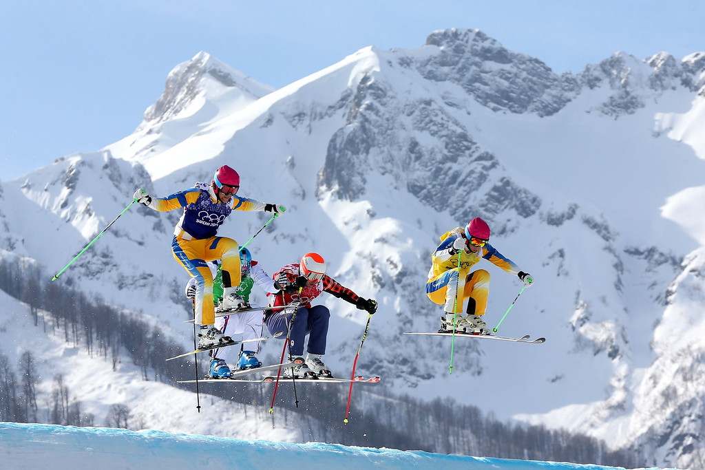. (L-R) Michael Forslund of Sweden, Arnaud Bovolenta of France, David Duncan of Canada and John Eklund of Sweden compete during the Freestyle Skiing Men\'s Ski Cross 1/8 Finals on day 13 of the 2014 Sochi Winter Olympic at Rosa Khutor Extreme Park on February 20, 2014 in Sochi, Russia.  (Photo by Mike Ehrmann/Getty Images)