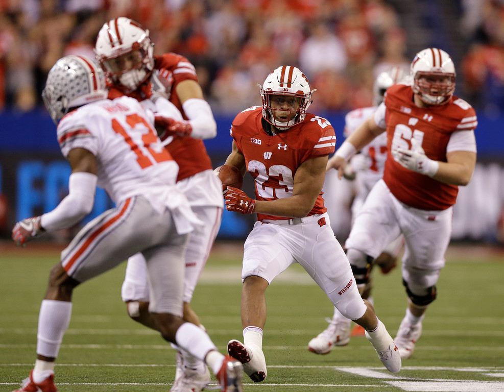 . Wisconsin\'s Jonathan Taylor (23) runs during the second half of the Big Ten championship NCAA college football game against Ohio State, Saturday, Dec. 2, 2017, in Indianapolis. (AP Photo/AJ Mast)