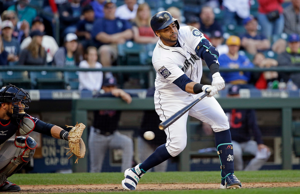 . Seattle Mariners\' Nelson Cruz, right, checks his swing as he strikes out looking to end a baseball game as Cleveland Indians catcher Yan Gomes looks on Saturday, Sept. 23, 2017, in Seattle. (AP Photo/Elaine Thompson)