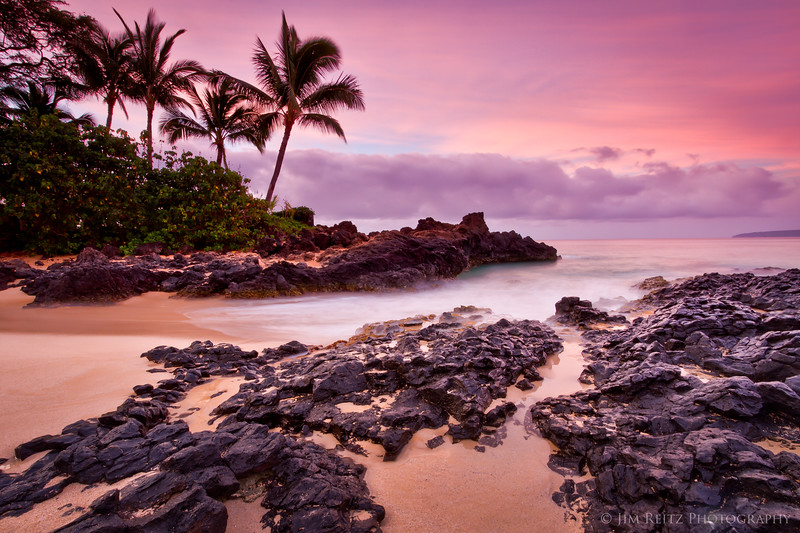 The clouds light up brilliant pink just at sunrise - Secret Beach, Maui