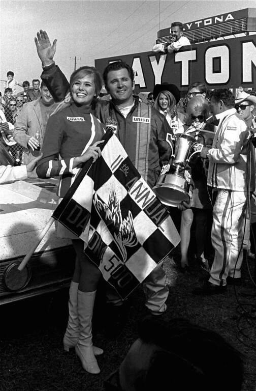 . Lee Roy Yarbrough holds his trophy and waves in victory lane after winning the Daytona 500 stock car race February 24, 1969 at the Daytona International Speedway.  Yarbrough, of Columbia, S.C., drove a 1969 Ford to win the 200-lap race over a 2.5 mile course.  (AP Photo/TY)