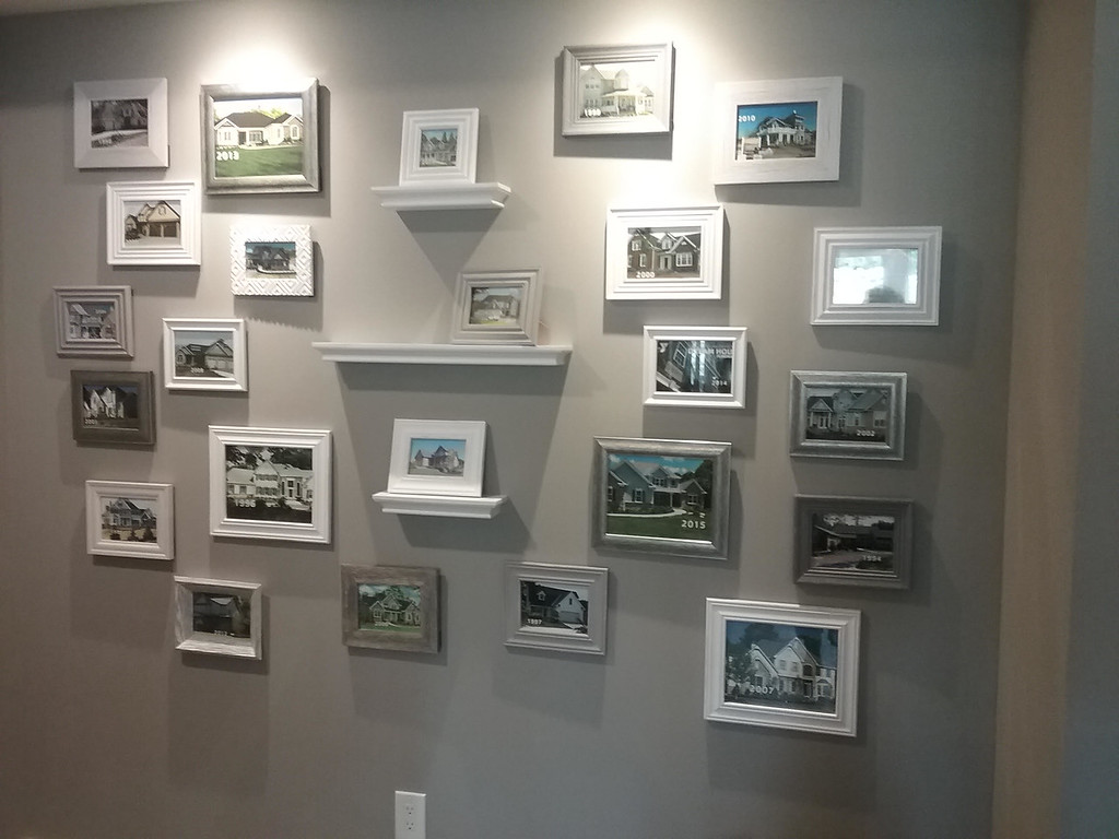 . Photos of each of the 25 Lake County YMCA Dream Houses are displayed on a feature wall in the lower level of the 2018 home in Mentor. (Jean Bonchak)