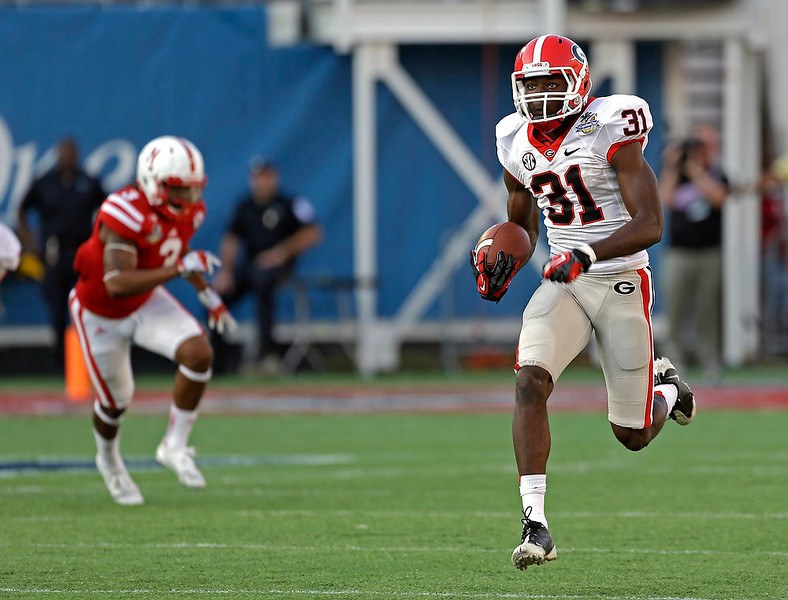 . Georgia wide receiver Chris Conley (31) runs for a touchdown on an 87-yard pass play past Nebraska safety Daimion Stafford (3) during the second half of the Capital One Bowl NCAA football game, Tuesday, Jan. 1, 2013, in Orlando, Fla. Georgia won the game 45-31.(AP Photo/John Raoux)