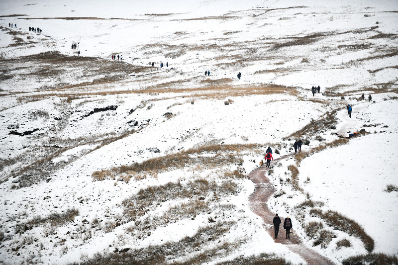 Wednesday 23rd January 2019 A line of people appears on Pen-y-Fan in the Brecon Beacons as a snow covered landscape attracts visitors to make their way up it's steep slopes to get a view of the wintry scene, as temperatures drop below freezing across Wales.