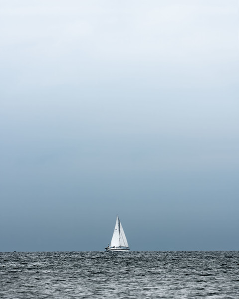 Boat white sails ocean photograph.jpg