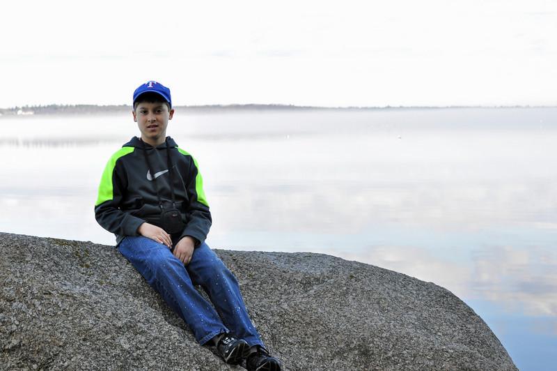 Landry on a rock in Frenchmen Bay with heavy fog.
