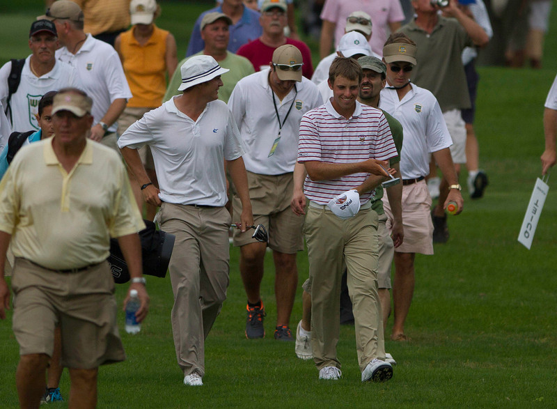 Jordan Russell (left) and Chris Williams chat as they walk up the 14th fairway during the finals of match play at the 2012 Western Amateur Championship at Exmoor Country Club in Highland Park, Ill., on Saturday, August 4, 2012. (WGA Photo/Charles Cherney)