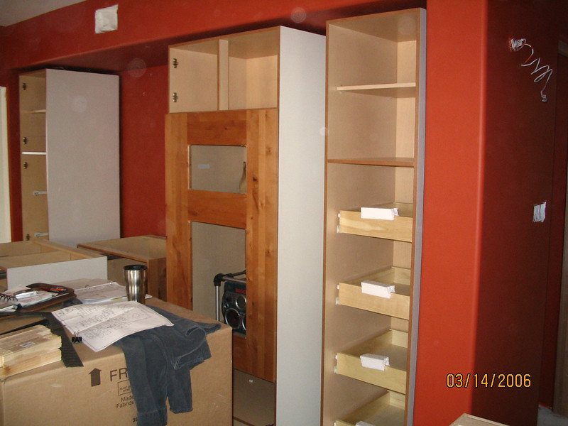 The pantries are in - shelves on rollers will make it easy to access pantry items.