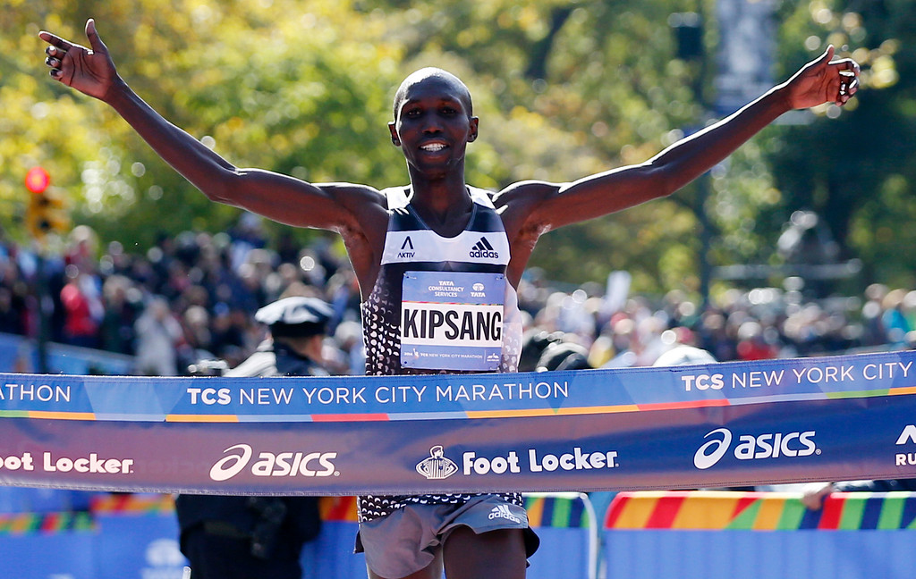 . Wilson Kipsang of Kenya celebrates as he hits the tape to win the men\'s division of the the 44th annual New York City Marathon in New York, Sunday, Nov. 2, 2014. Kipsang won in an unofficial time of 2 hours, 10 minutes, 59 seconds. (AP Photo/Kathy Willens)