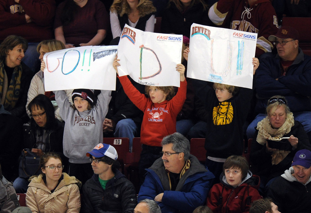 . University of Denver fans cheer the team during the game against Boston University at Magness Arena on in Denver on Saturday, Dec. 29, 2012. Hyoung Chang, The Denver Post