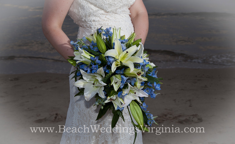 white lilies, blue accents, cascading
