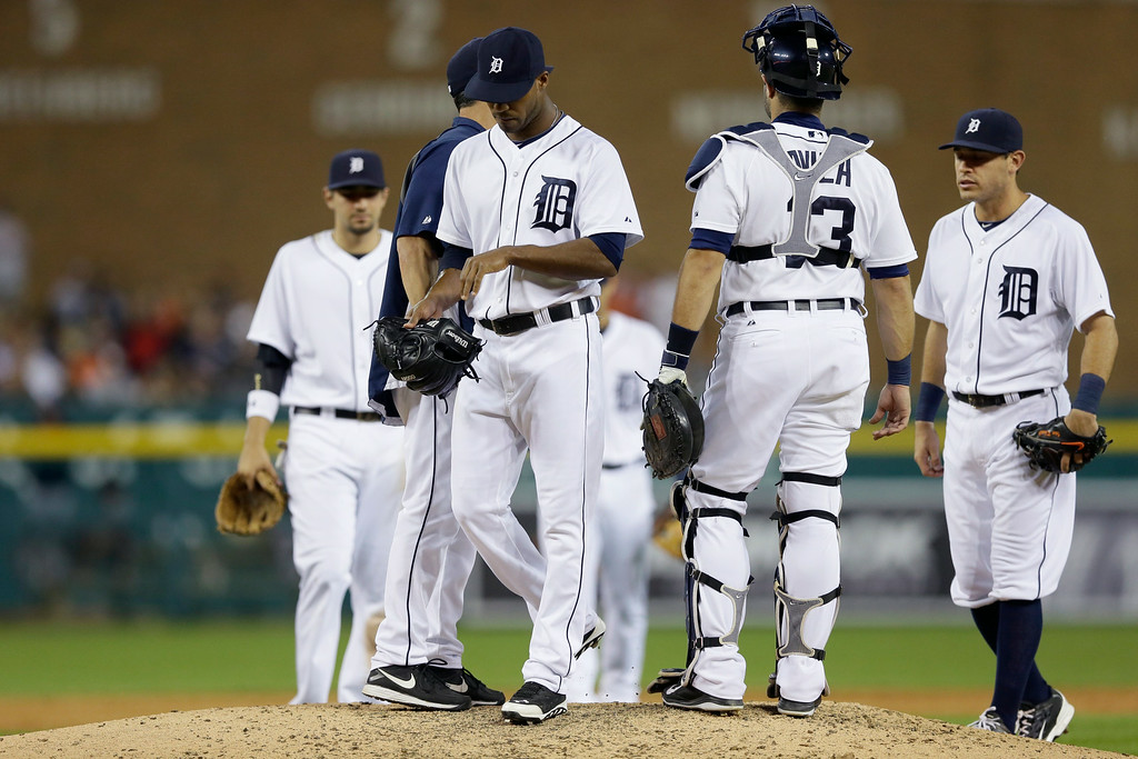 . Detroit Tigers relief pitcher Al Alburquerque is relieved after giving up four runs on two home runs during the seventh inning of a baseball game against the Cleveland Indians in Detroit, Friday, July 18, 2014. (AP Photo/Carlos Osorio)