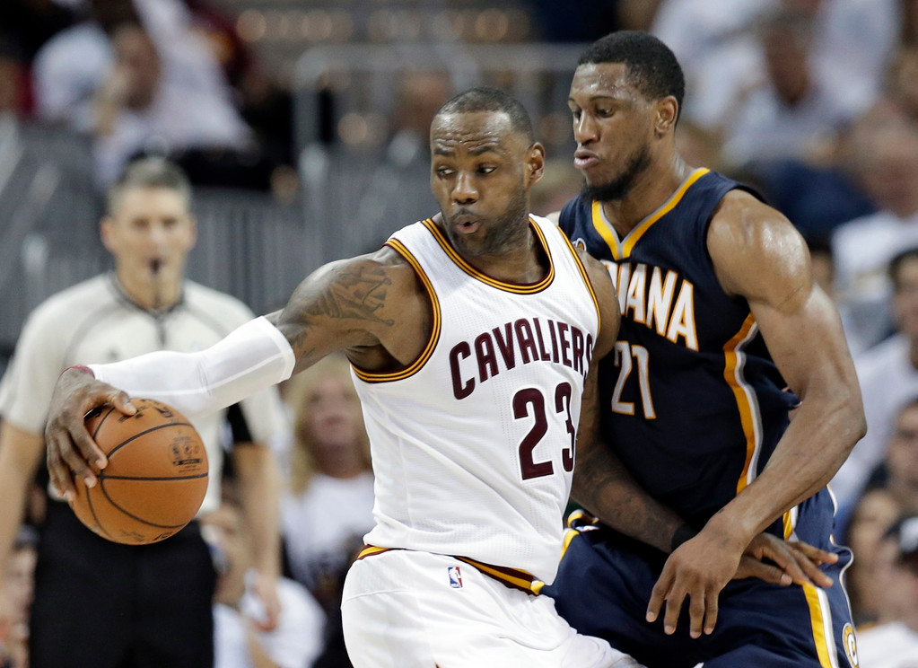 . Cleveland Cavaliers\' LeBron James (23) drives around Indiana Pacers\' Thaddeus Young (21) in the second half in Game 1 of a first-round NBA basketball playoff series, Saturday, April 15, 2017, in Cleveland. The Cavaliers won 109-108. (AP Photo/Tony Dejak)