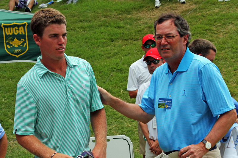 Warren Stephens, founder of The Alotian Club, wishes Sean Dale luck before the championship match of the 111th Western Amateur. (WGA Photo/Ian Yelton)