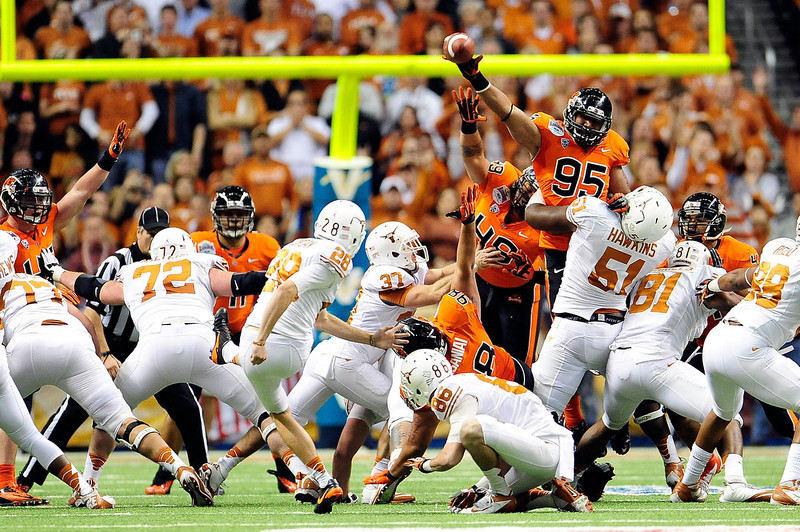 . Scott Crichton #95 of the Oregon State Beavers blocks a field goal attempt by Nick Jordan #28 of the University of Texas Longhorns during the Valero Alamo Bowl at the Alamodome on December 29, 2012 in San Antonio, Texas.  (Photo by Stacy Revere/Getty Images)