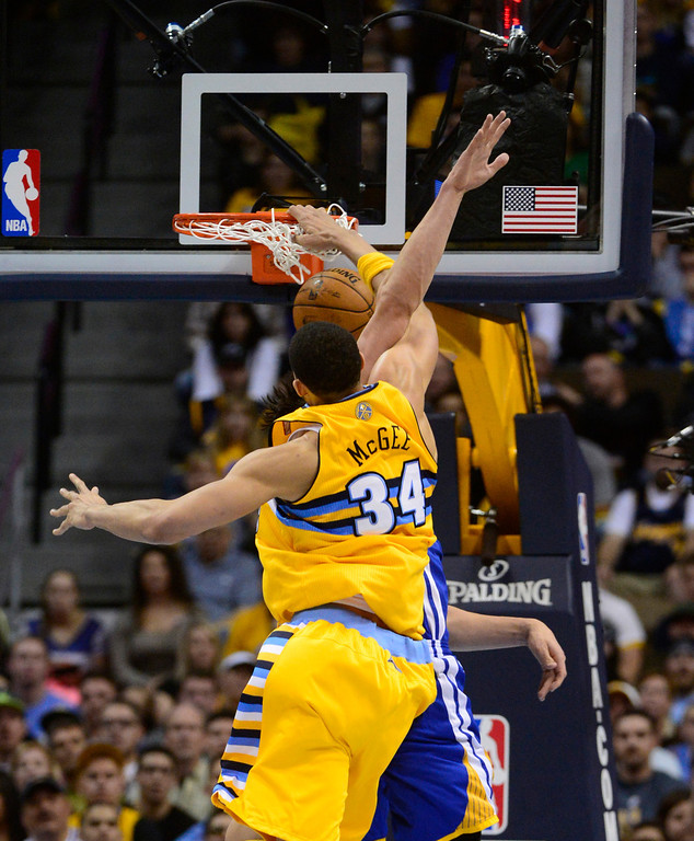 . DENVER, CO. - APRIL 20: Denver Nuggets center JaVale McGee (34) dunks on an opponent during the second quarter. The Denver Nuggets took on the Golden State Warriors in Game 1 of the Western Conference First Round Series at the Pepsi Center in Denver, Colo. on April 20, 2013. (Photo by AAron Ontiveroz/The Denver Post)