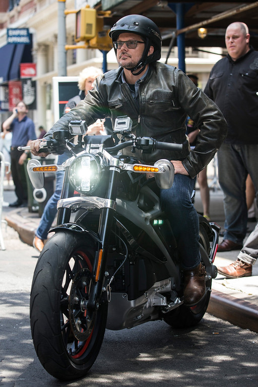 . Mark-Hans Richer, Harley Davidson\'s chief marketing officer, rides a Harley Davidson Livewire motorcycle, the company\'s first electric bike, at a press conference at the Harley Davidson Store on June 23, 2014 in New York City. The Livewire has 74 horsepower and a top speed of 92 miles per hour.  (Photo by Andrew Burton/Getty Images)