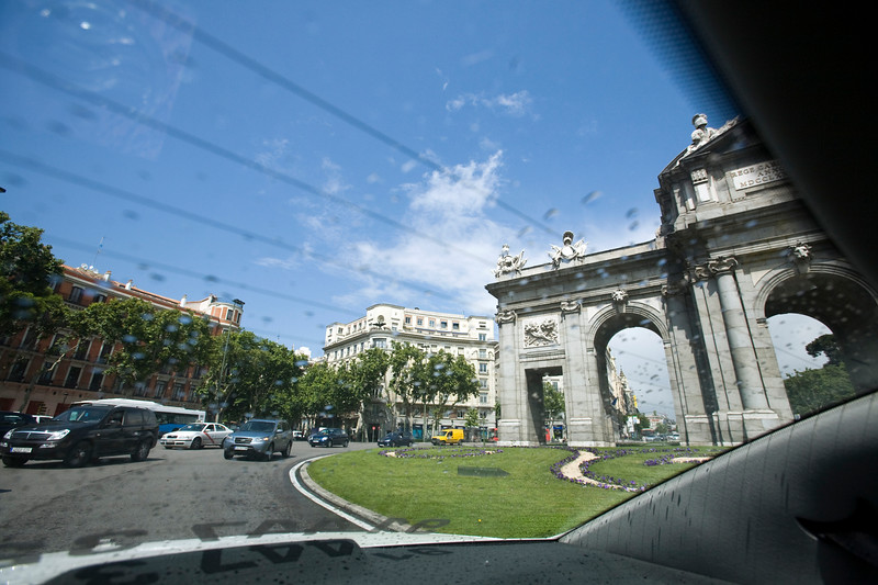 Alcala gate seen through the rear window of a taxi, Madrid, Spain