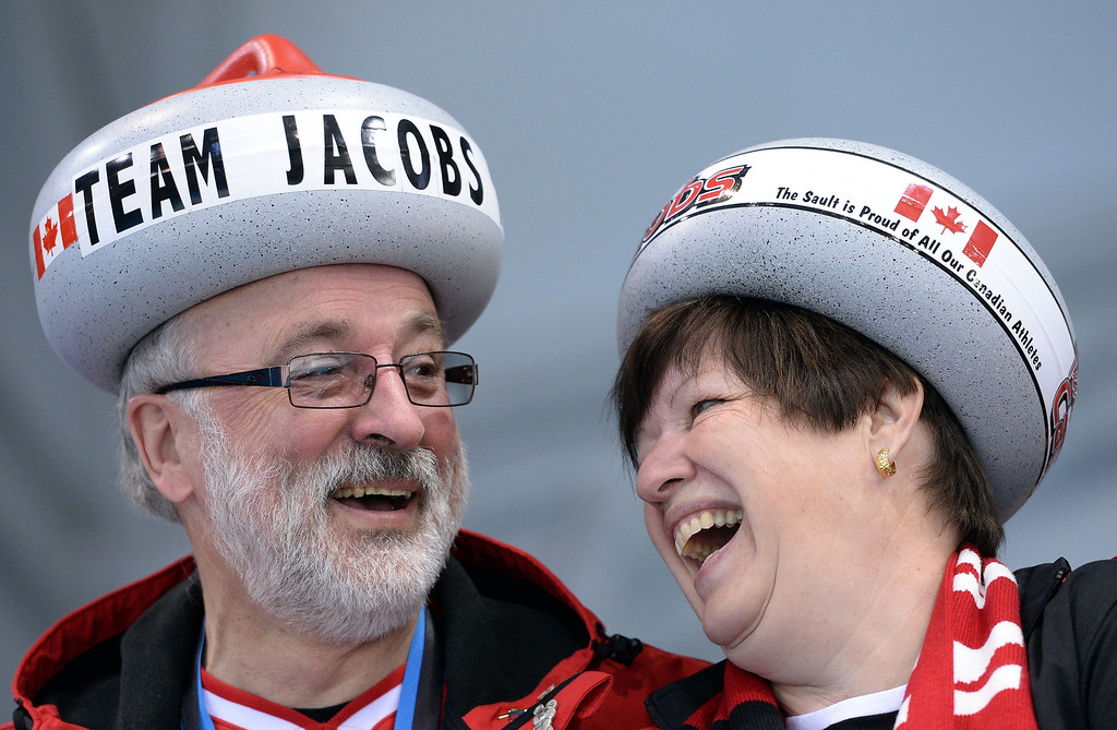 . Canada\'s supporters cheer during the Men\'s Curling Round Robin Session 10 at the Ice Cube Curling Center during the Sochi Winter Olympics on February 16, 2014.   ANDREJ ISAKOVIC/AFP/Getty Images