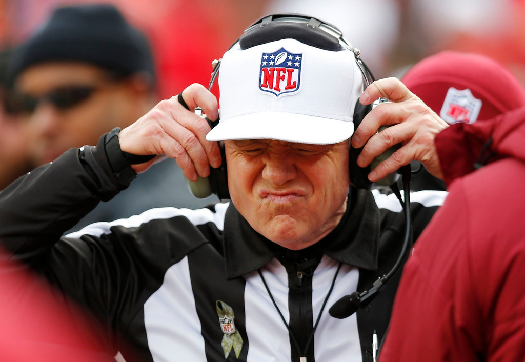 . Referee Walt Coleman wears a headset to review a play during the first half of an NFL football game between the San Diego Chargers and the Kansas City Chiefs at Arrowhead Stadium in Kansas City, Mo., Sunday, Nov. 24, 2013. (AP Photo/Ed Zurga)