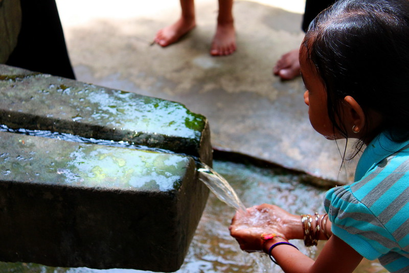 Washing with holy water from a Linga image