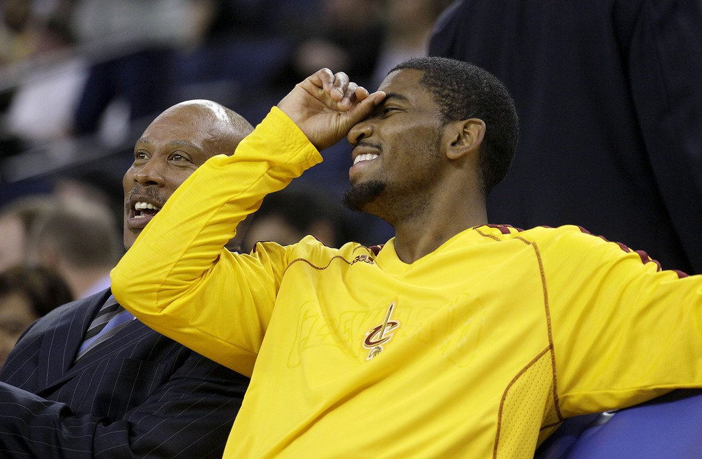 . Cleveland Cavaliers point guard Kyrie Irving, right, laughs with Cleveland Cavaliers head coach Byron Scott before an NBA basketball game against the Golden State Warriors in Oakland, Calif., Wednesday, Nov. 7, 2012. (AP Photo/Jeff Chiu)