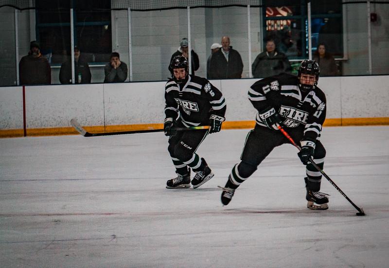 Holy Family Boys Varsity Hockey vs. Elk River, 12/27/19: Luke Roelofs '21 (11)