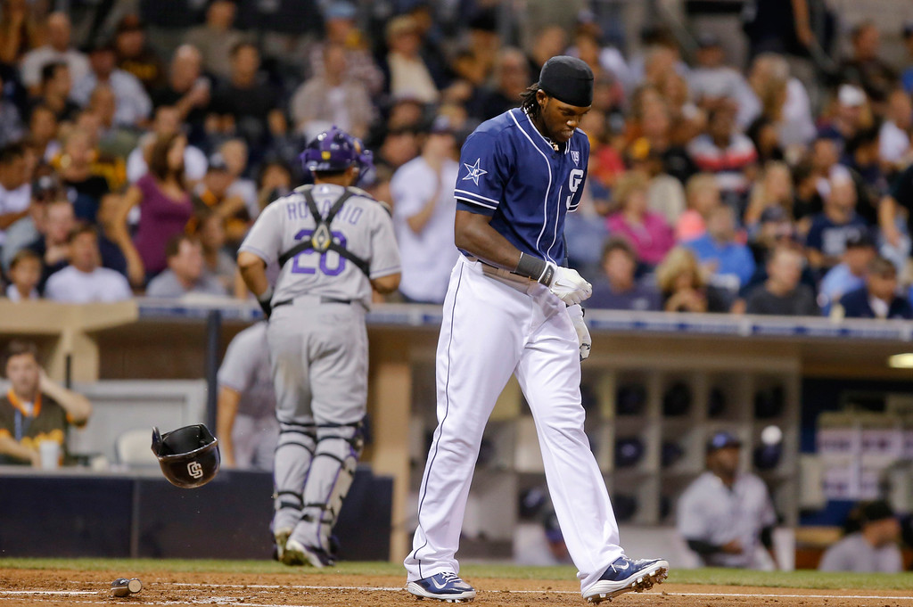 . San Diego Padres\' Cameron Maybin heads out to his position after striking out to end the third inning of a baseball game against the Colorado Rockies on Tuesday, Sept. 23, 2014, in San Diego. (AP Photo/Lenny Ignelzi)