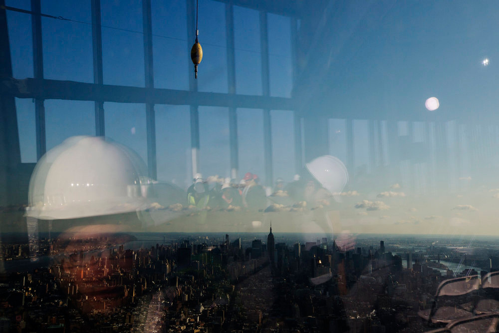 . Members of the media are reflected in the windows of the 100th floor observation deck in OneWorldTradeCenter before a press conference in New York, April 2, 2013. Port Authority officials unveiled Tuesday the stunning view from the top of OneWorldTradeCenter, a 360-degree eagle�s eye panorama that will instantly become one of the city�s premiere tourist attractions when it is completed in 2015. REUTERS/Lucas Jackson