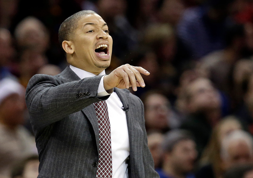 . Cleveland Cavaliers head coach Tyronn Lue yells to players in the first half of an NBA basketball game against the Golden State Warriors, Sunday, Dec. 25, 2016, in Cleveland. The Cavaliers won 109-108. (AP Photo/Tony Dejak)