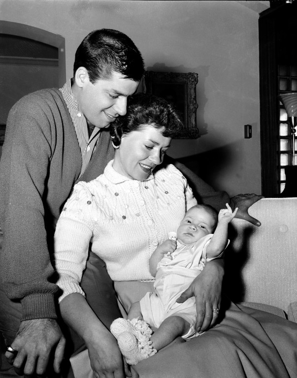 . Actor-comedian Jerry Lewis and his wife, singer Patti, pose with their third son, Scott Anthony Lewis, 6 1/2 weeks old, in Los Angeles, Ca., April 12, 1956. Lewis, the comedian and director whose fundraising telethons became as famous as his hit movies, has died. Publicist Candi Cazau said Lewis passed away Sunday, Aug. 20, 2017, at age 91 in Las Vegas with his family by his side.  (AP Photo)