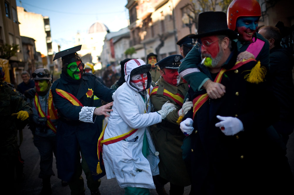. Revelers in fancy dress walk toward the battle of \'Enfarinats\', a flour fight in celebration of the Els Enfarinats festival on December 28, 2012 in Ibi, Spain. Citizens of Ibi annually celebrate the festival with a battle using flour, eggs and firecrackers. The battle takes place between two groups, a group of married men called \'Els Enfarinats\' which take the control of the village for one day pronouncing a whole of ridiculous laws and fining the citizens that infringe them and a group called \'La Oposicio\' which try to restore order. At the end of the day the money collected from the fines is donated to charitable causes in the village. The festival has been celebrated since 1981 after the town of Ibi recovered the tradition but the origins remain unknown.�  (Photo by David Ramos/Getty Images)