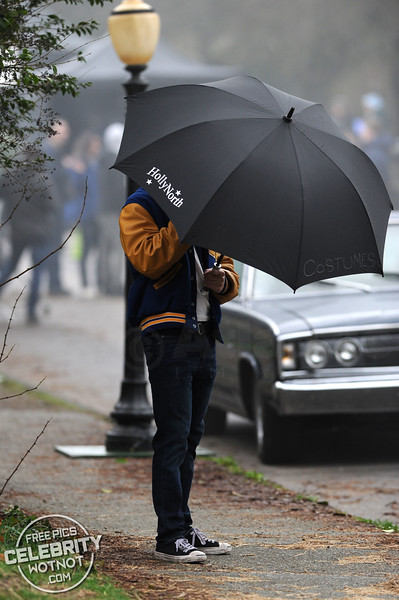 KJ Apa Filming Riverdale In His Iconic Letterman Jacket With Personal Umbrella Holder