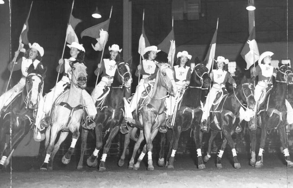 . Carrying Colorful Guidons, The Westernaires execute a precision turn in their show at Stockyard stadium. 1957. Jack Urwiller, The Denver Post