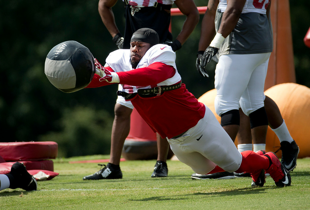 . Atlanta Falcons defensive tackle Jonathan Babineaux (95) works during an NFL football training camp Tuesday, July 29, 2014 in Flowery Branch, Ga. (AP Photo/John Bazemore)