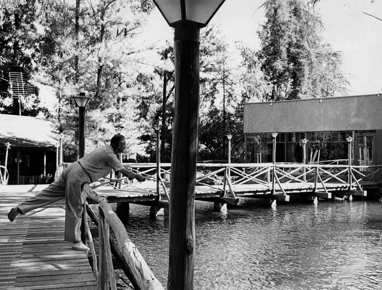 . Man casts fishing rod into water at the Sportsmen\'s Lodge, Studio City in the 1960s.   (Los Angeles Public Library)