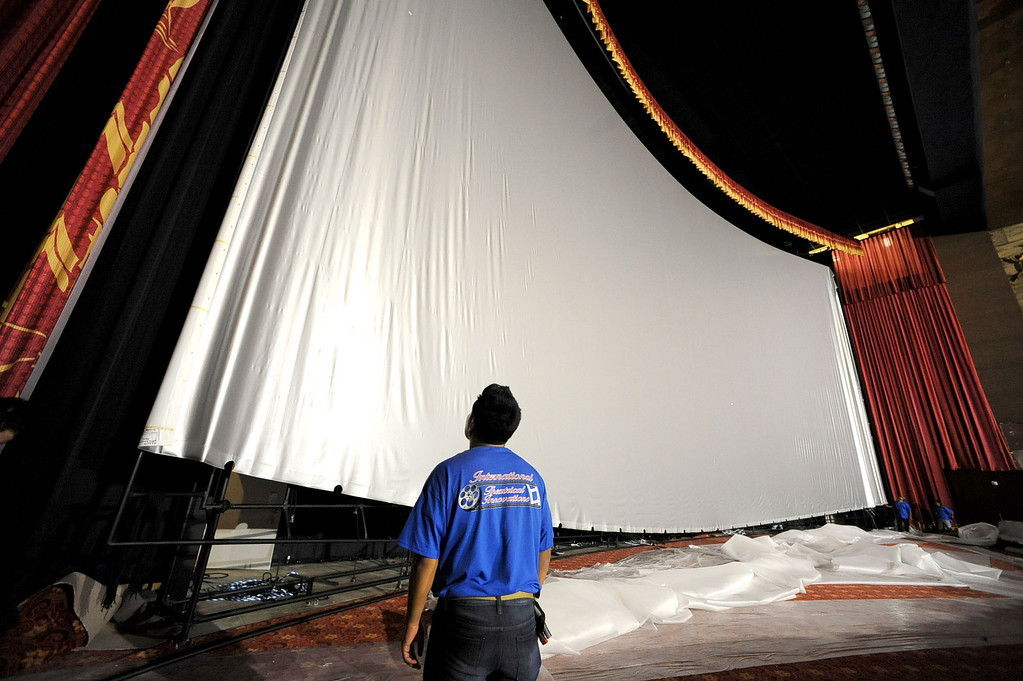 . A worker looks on as workers secure the 94\'X46\' IMAX screen inside the TCL Chinese Theatre in Hollywood, CA August 23, 2013.  After a summer hiatus, the TCL Chinese Theatre is reopening as the world�s biggest IMAX Theatre with a showing of the Wizard of Oz on September 20th.(Andy Holzman/Los Angeles Daily News)