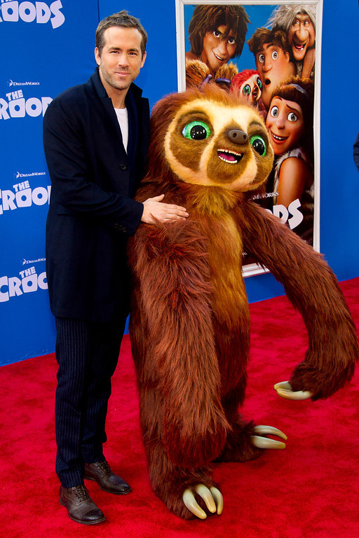 ". Ryan Reynolds poses with Belt the sloth at ""The Croods\"" premiere on Sunday, March 10, 2013 in New York. (Photo by Charles Sykes/Invision/AP)"