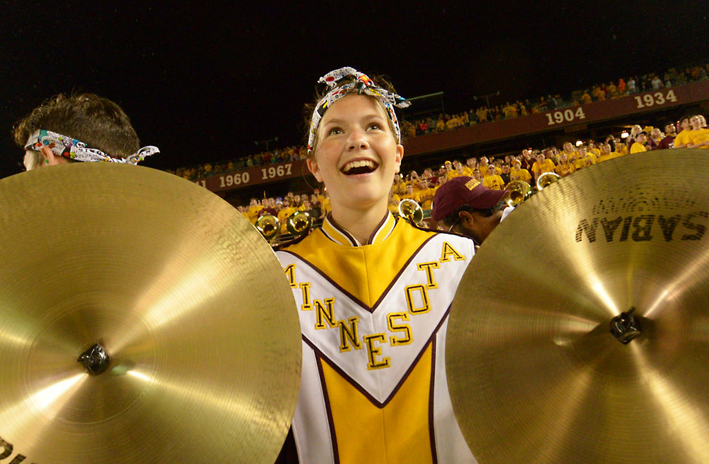 . University of Minnesota senior marching band member Lauren Shibley plays the cymbals as the Gophers take on Eastern Illinois in the fourth quarter. (Pioneer Press: John Autey)