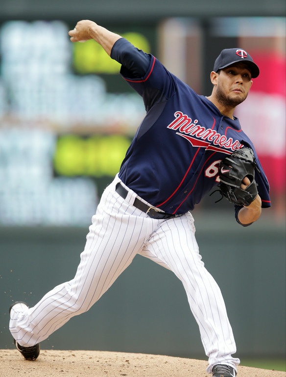 . Minnesota Twins pitcher Yohan Pino throws against the Detroit Tigers in the first inning of a baseball game, Saturday,  Aug. 23, 2014, in Minneapolis. (AP Photo/Jim Mone)