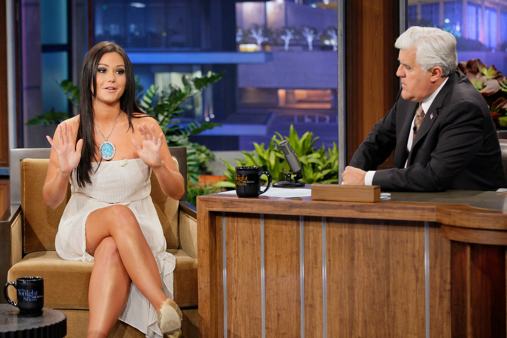 ". This Oct. 30, 2012 photo released by NBC shows Jenni ""JWoww\"" Farley, a cast member in the reality series \""Jersey Shore,\"" left, and host Jay Leno on \""The Tonight Show with Jay Leno,\"" in Burbank, Calif. Seaside Heights, the New Jersey town that for millions made ?Jersey Shore? synonymous with Snooki was among the hardest hit by Superstorm Sandy and its famous summer residents sent their prayers to those affected. Farley and fellow cast members Paul \""Pauly D\"" DelVecchio, Vinny Guadagnino asked their Twitter followers to donate to the American Red Cross. (Photo by: Paul Drinkwater/NBC)"