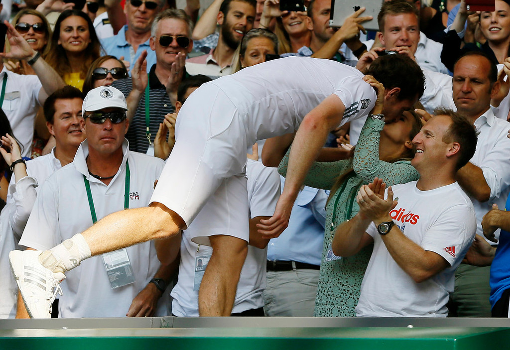 . Andy Murray of Britain, center, kisses his girlfriend Kim Sears after defeating Novak Djokovic of Serbia during the Men\'s singles final match at the All England Lawn Tennis Championships in Wimbledon, London, Sunday, July 7, 2013. (AP Photo/Kirsty Wigglesworth)