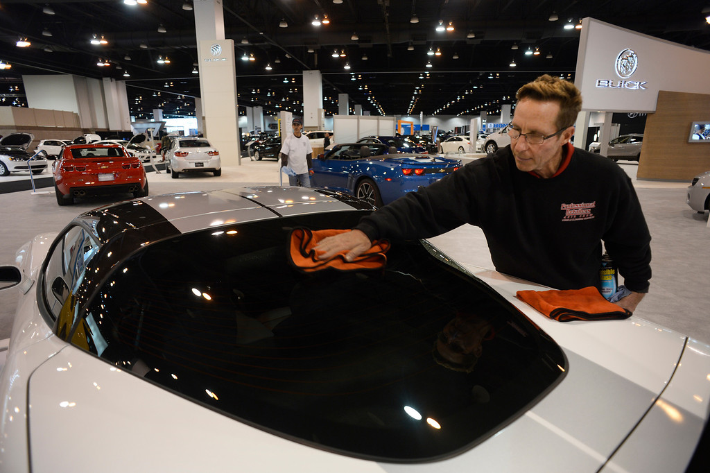 ". DENVER, CO- MARCH 19: Mike Price, with Professional Detailers, cleans the windows on a 50th anniversary 2013 ZR 1 Corvette Coupe on display on the showroom floor at the Denver Auto Show.   The Denver Auto Show is scheduled to open Wednesday so preparation for the show is in full swing on March 19, 2013.  The show, which is at the Denver Convention Center, will run through the weekend.  The auto industry is putting renewed emphasis on natural gas-powered vehicles. The low prices of natural gas makes them an attractive option, especially for fleet operators. But a dearth of fueling stations. Also of interest at the show is the new prevalence of luxury cars such as Mercedes offering  ""affordable luxury\' models such as the Mercedes-Benz CLA, starting at $29,900. (Photo By Helen H. Richardson/ The Denver Post)"