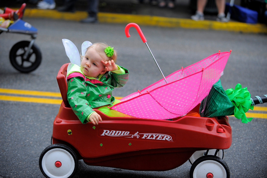 . Adelaide Lynch takes part in her second St. Patrick\'s Day parade with her parents, Monday, March 17,  2014, in Savannah, Ga. (AP Photo/Stephen B. Morton)