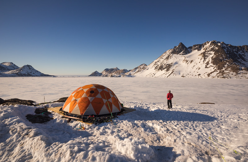 Cameron Bhair at sunrise by Base Camp, East Greenland