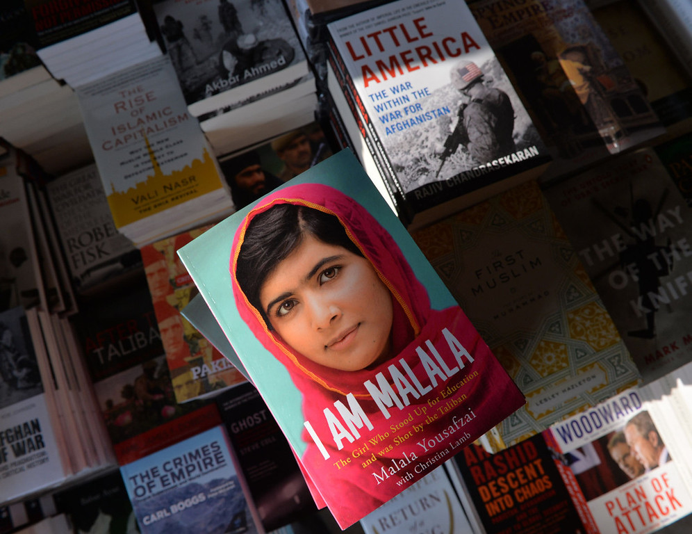 """. A copy of the memoirs of Pakistani child activist Malala Yousafzai is pictured in a bookstore in Islamabad on October 8, 2013. Pakistani schoolgirl Malala Yousafzai tells of the moment she was shot by the Taliban for campaigning for girls\' education in her new autobiography out on October 8, amid speculation that she may be about to become the youngest ever winner of the Nobel Peace Prize. Co-written with British journalist Christina Lamb, \""""I Am Malala: The Girl Who Stood Up for Education and was Shot by the Taliban\"""" tells of the 16-year-old\'s terror as two gunmen boarded her schoolbus on October 9, 2012 and shot her in the head.   AAMIR QURESHI/AFP/Getty Images"""