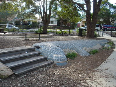crocodile sculpture with inlaid tiles and timber steps